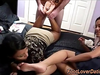 Footjob and feet licking by hot lesbians